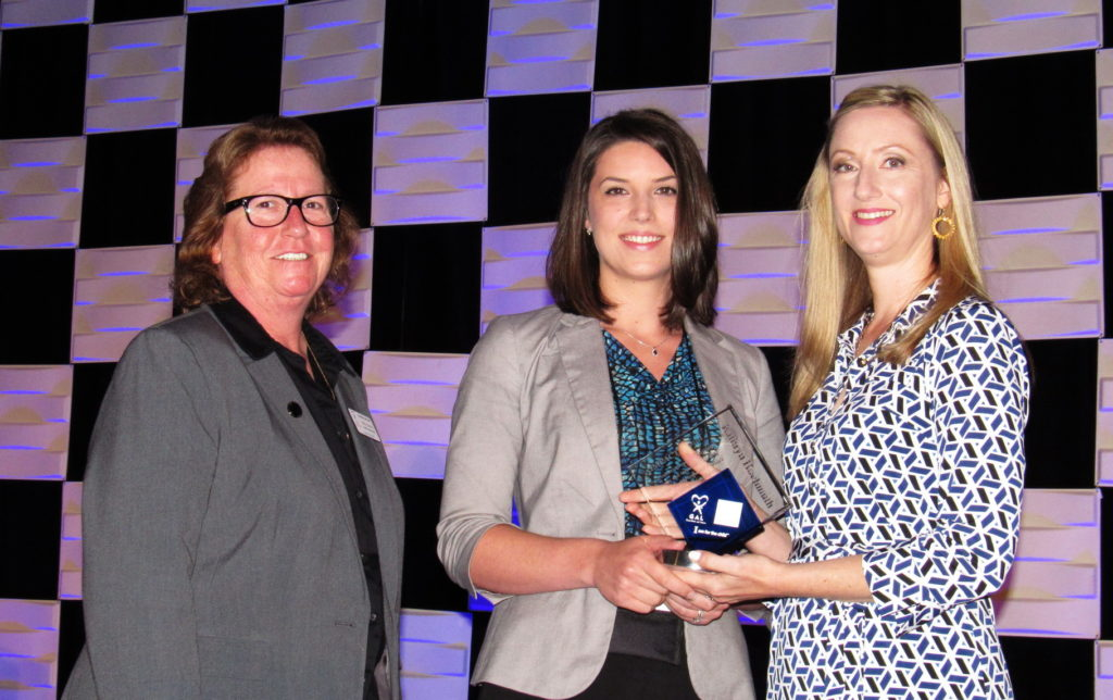 [Pictured Kathryn Hochmuth (middle) receiving the Impact Award from Statewide GAL Legal Director Kelly Swartz(left) and Ackerman's Director of Pro Bono Initiatives Whitley M. Untiedt (right).]